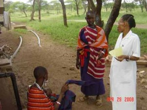 Nurse Mary Mariki and clients at Nomeuti Dispensary